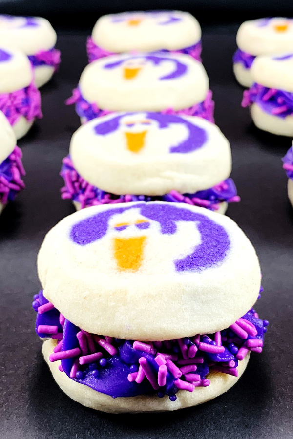 Ghost Cookies with Purple Frosting and Sprinkles