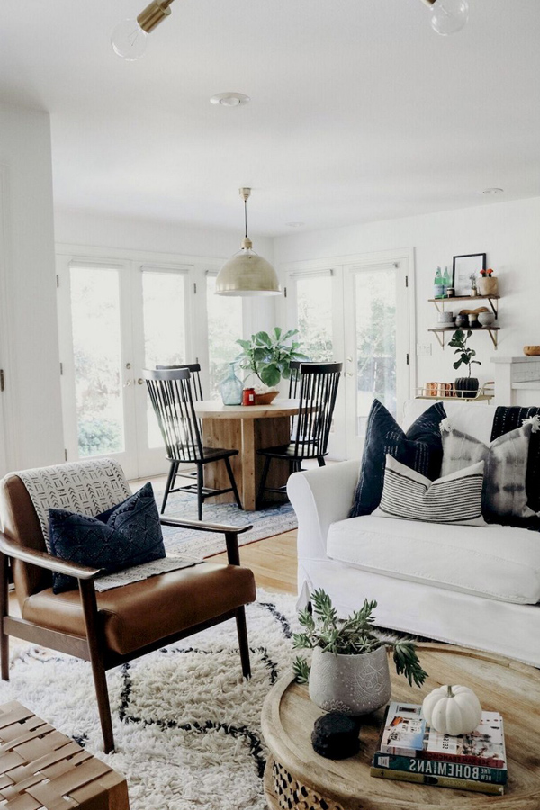 Tan leather chair and white couch modern farmhouse couch in bright airy living room - Design Inspiration Curated by Rare and Worthy Co