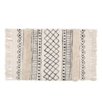White throw rug with black tribal pattern