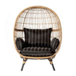Rattan egg chair with black patterned cushions
