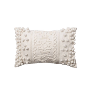 Ivory Embellished pom pom throw pillow for a cozy modern farmhouse living room design curated by Rare and Worthy Co